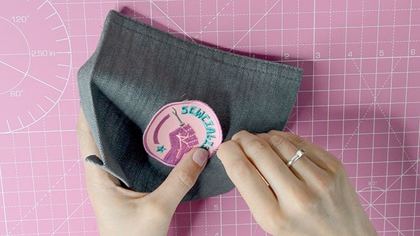 Sewing on patch by hand